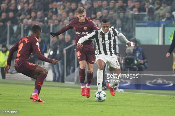 Alex Sandro and Gerard Deulofeu compete for the ball during the UEFA Champions League football match between Juventus FC and FC Barcelona at Allianz...