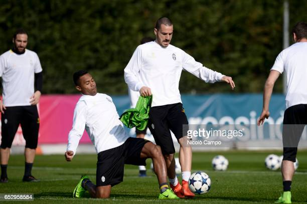 Alex Sandro and Leonardo Bonucci compete for the ball during the Juventus FC training on the eve of the UEFA Champions League football match between...