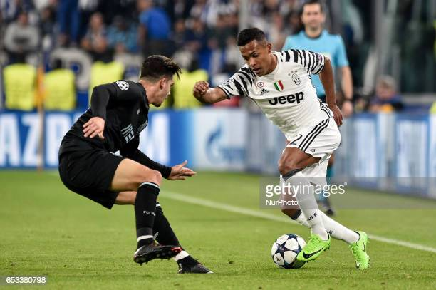 Alex Sandro defender of Juventus FC is challenged by Porto's Portuguese forward Andre Silva during the UEFA Champions League Round of 16 2st leg...