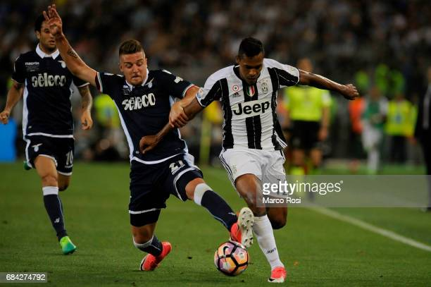 Alex Sandro of FC Juventus compete for the ball with Sergej Milinkovic Savic of SS Lazio during the TIM Cup Final match between SS Lazio and Juventus...