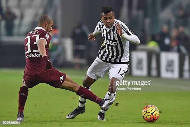 Alex Sandro of FC Juventus is challenged by Bruno Peres of Torino FC during the TIM Cup match between FC Juventus and Torino FC at Juventus Arena on...