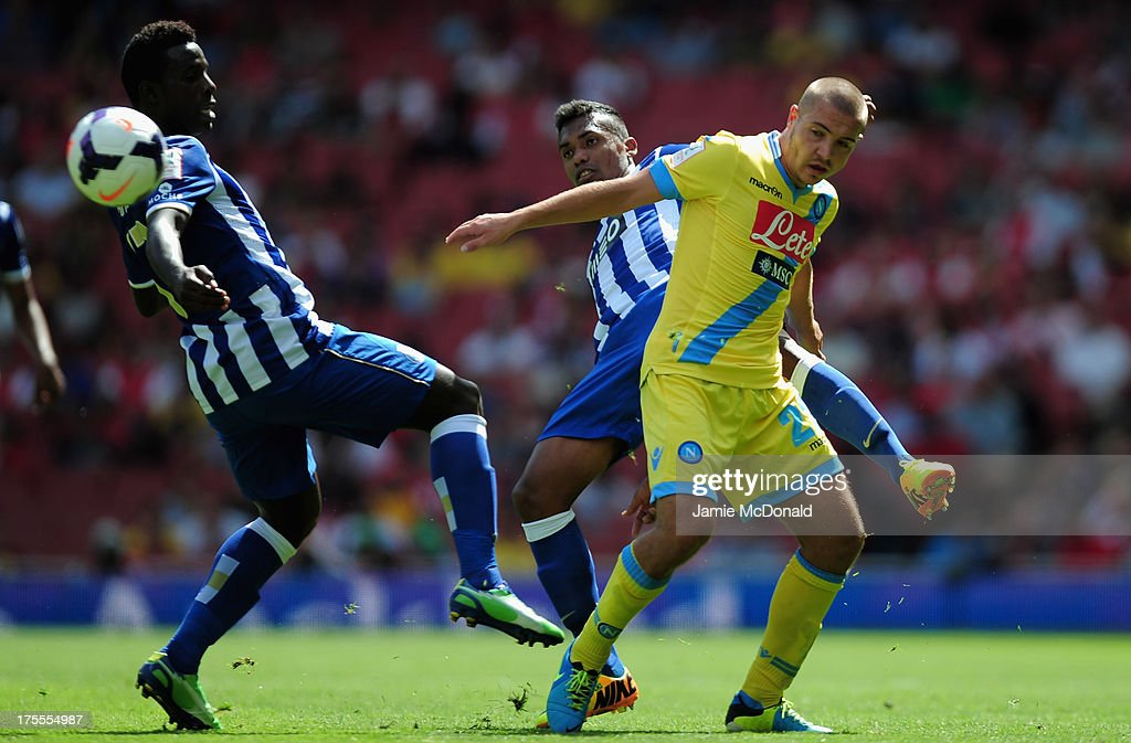 Alex Sandro of FC Porto battles with Josip Radosovic of Napoli during the Emirates Cup match between Napoli and FC Porto at the Emirates Stadium on August 4, 2013 in London, England.