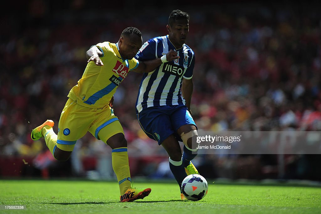 Alex Sandro of FC Porto battles with Juan Zuniga of Napoli during the Emirates Cup match between Napoli and FC Porto at the Emirates Stadium on August 4, 2013 in London, England.