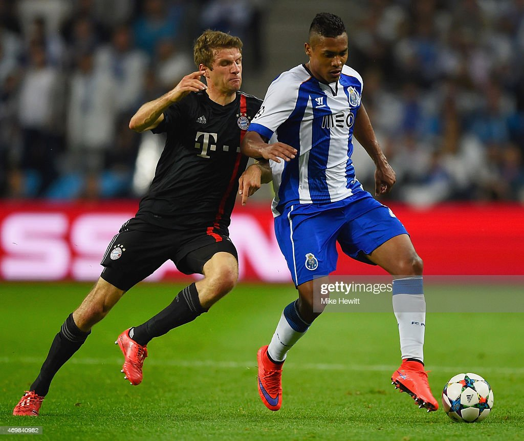 Alex Sandro of FC Porto is chased by Thomas Mueller of Bayern Muenchen during the UEFA Champions League Quarter Final first leg match between FC...