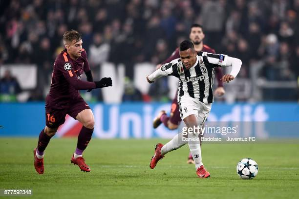 Alex Sandro of Juventus and Gerard Deulofeu of Barcelona compete for the ball during the UEFA Champions League group D match between Juventus and FC...