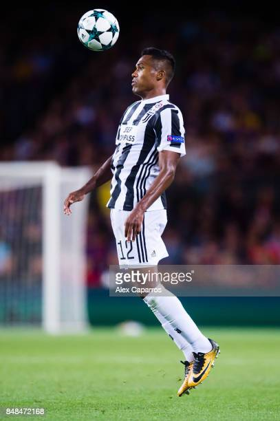 Alex Sandro of Juventus controls the ball during the UEFA Champions League group D match between FC Barcelona and Juventus at Camp Nou on September...