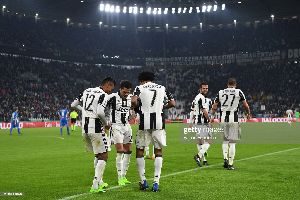 Alex Sandro (L) of Juventus FC celebrates a goal with team mates Daniel Alves (C) and Juan Cuadrado during the Serie A match between Juventus FC and Empoli FC at Juventus Stadium on February 25, 2017 in Turin, Italy.