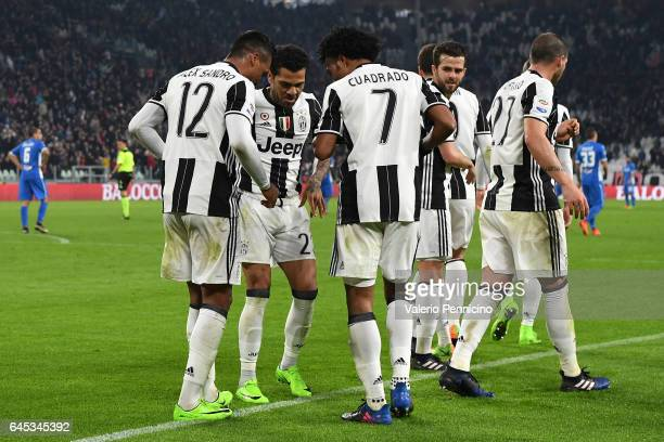 Alex Sandro of Juventus FC celebrates a goal with team mates Daniel Alves and Juan Cuadrado during the Serie A match between Juventus FC and Empoli...