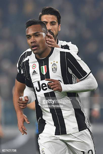 Alex Sandro of Juventus FC celebrates after scoring the opening goal with team mate Sami Khedira during the Serie A match between Juventus FC and...