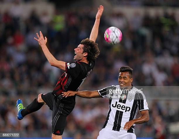 Alex Sandro of Juventus FC competes for the ball with Andrea Poli of AC Milan during the TIM Cup final match between AC Milan and Juventus FC at...