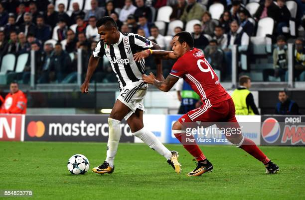 Alex Sandro of Juventus FC competes for the ball with Felipe Pardo of Olympiakos Piraeus of during the UEFA Champions League group D match between...