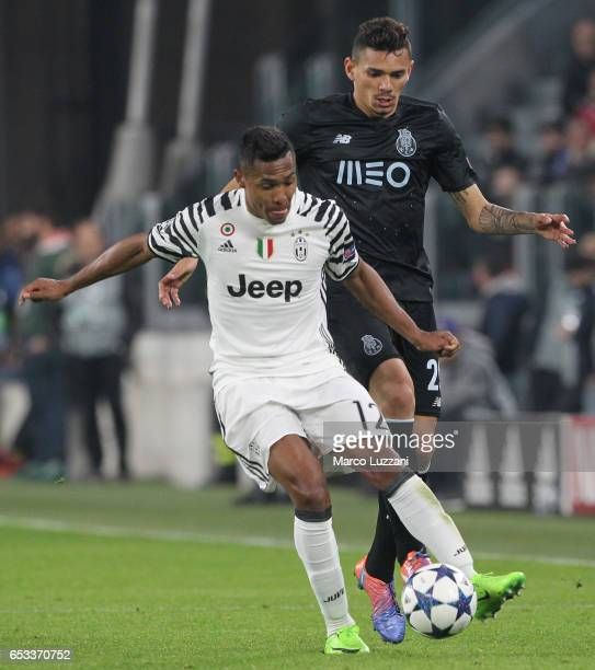 Alex Sandro of Juventus FC competes for the ball with Francisco Soares of FC Porto during the UEFA Champions League Round of 16 second leg match...