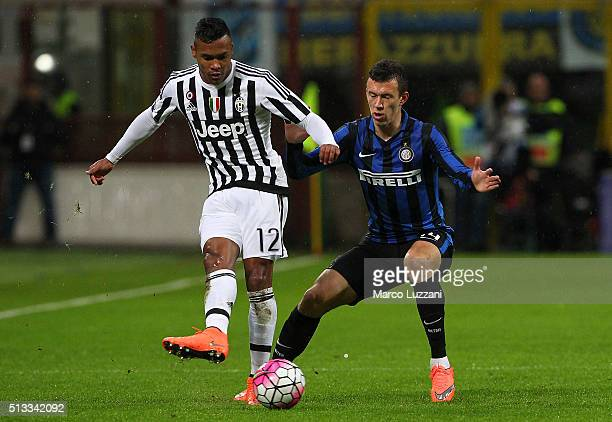 Alex Sandro of Juventus FC competes for the ball with Ivan Perisic of FC Internazionale Milano during the TIM Cup match between FC Internazionale...