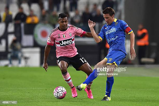 Alex Sandro of Juventus FC competes with Alessandro Frara of Frosinone Calcio during the Serie A match between Juventus FC and Frosinone Calcio at...