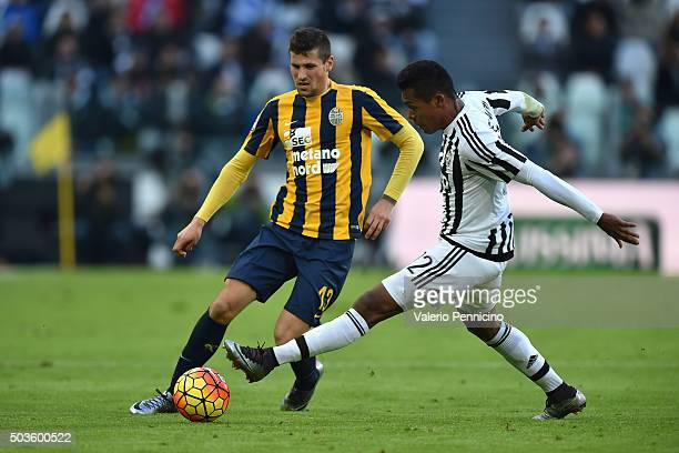 Alex Sandro of Juventus FC competes with Pawel Wszolek of Hellas Verona FC during the Serie A match between Juventus FC and Hellas Verona FC at...