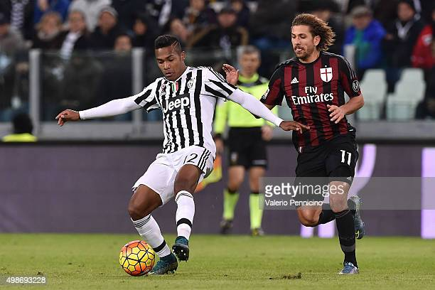 Alex Sandro of Juventus FC in action against Alessio Cerci of AC Milan during the Serie A match between Juventus FC and AC Milan at Juventus Arena on...