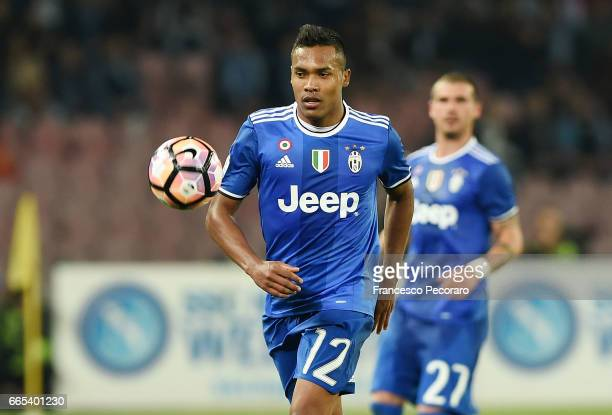 Alex Sandro of Juventus FC in action during the TIM Cup match between SSC Napoli and Juventus FC at Stadio San Paolo on April 5 2017 in Naples Italy
