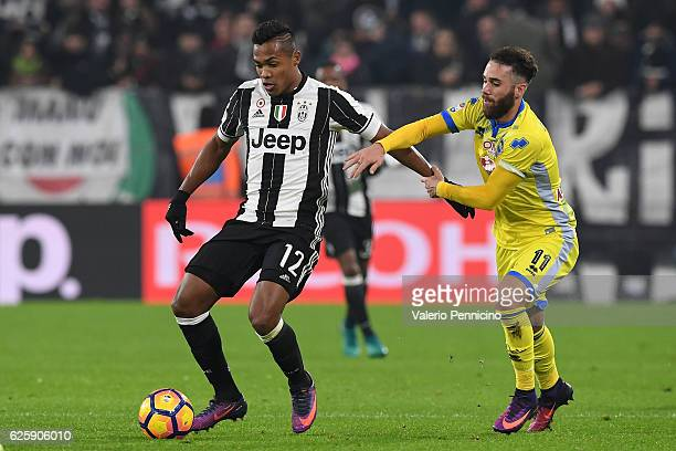 Alex Sandro of Juventus FC is challenged by Francesco Zampano of Pescara Calcio during the Serie A match between Juventus FC and Pescara Calcio at...