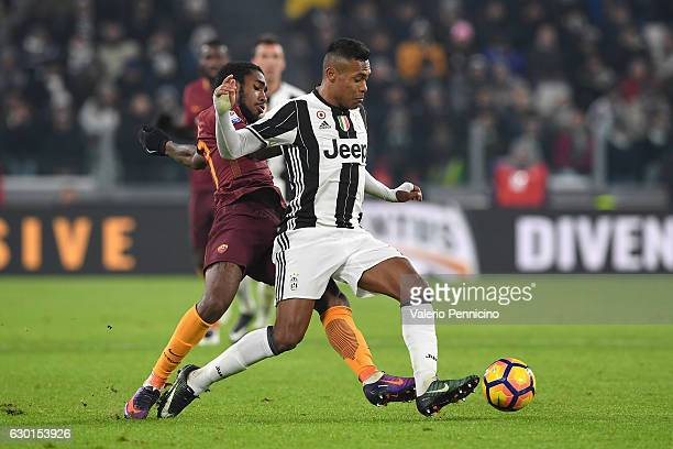 Alex Sandro of Juventus FC is challenged by Gerson of AS Roma during the Serie A match between Juventus FC and AS Roma at Juventus Stadium on...