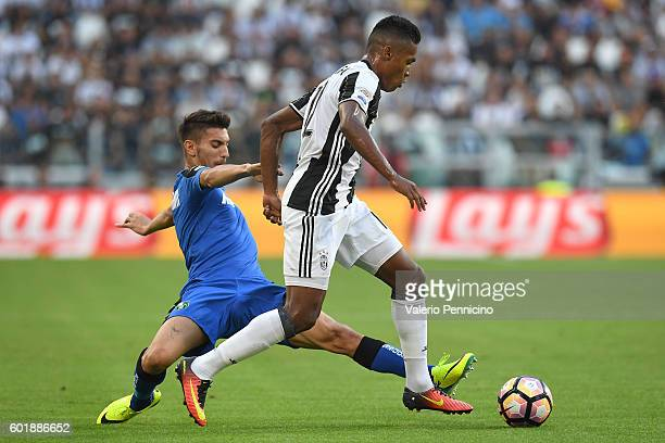 Alex Sandro of Juventus FC is challenged by Lorenzo Pellegrini of US Sassuolo during the Serie A match between Juventus FC and US Sassuolo at...