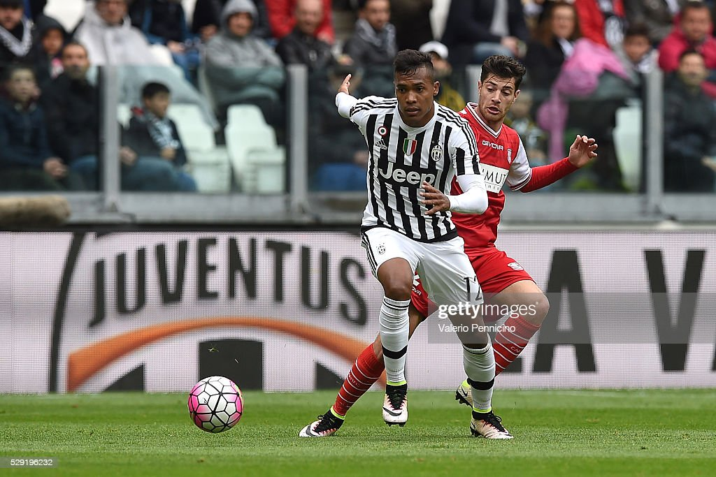 Alex Sandro (R) of Juventus FC is challenged by Stefano Sabelli of Carpi FC during the Serie A match between Juventus FC and Carpi FC at Juventus Arena on May 1, 2016 in Turin, Italy.
