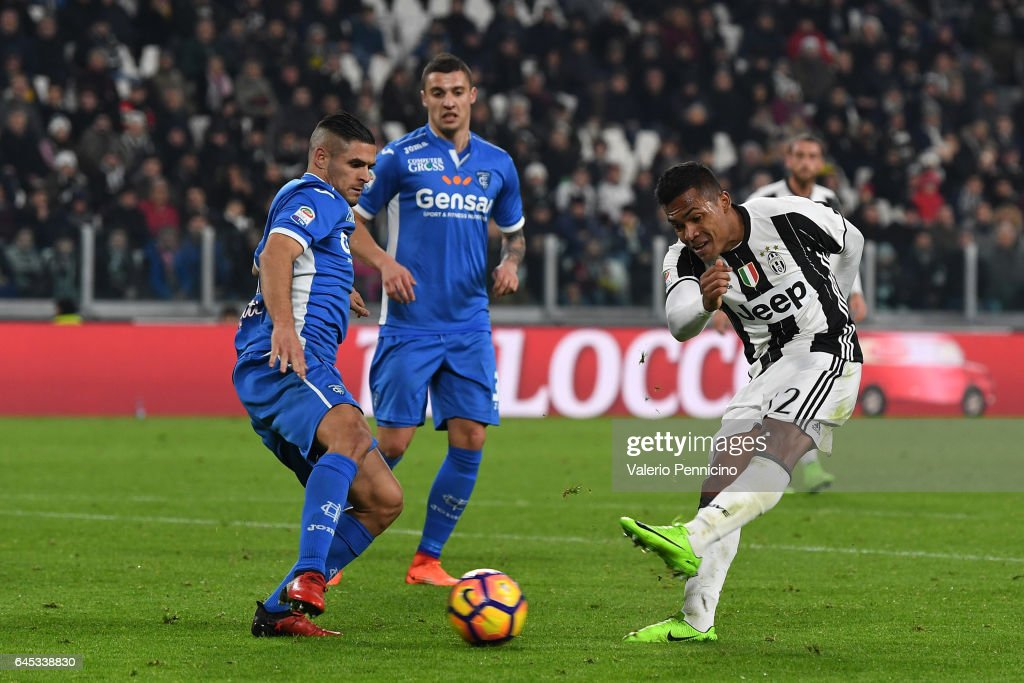 Alex Sandro (R) of Juventus FC scores a goal during the Serie A match between Juventus FC and Empoli FC at Juventus Stadium on February 25, 2017 in Turin, Italy.