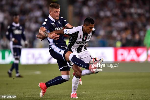 Alex Sandro of Juventus is challenged by Sergej MilinkovicSavic of Lazio during the Italian Tim Cup 2017 match between Juventus and Lazio at Stadio...