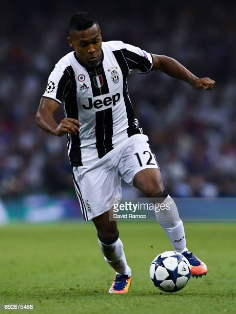 Alex Sandro of Juventus runs with the ball during the UEFA Champions League Final between Juventus and Real Madrid at National Stadium of Wales on...