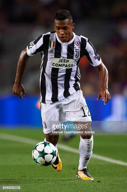 Alex Sandro of Juventus runs with the ball during the UEFA Champions League group D match between FC Barcelona and Juventus at Camp Nou on September...