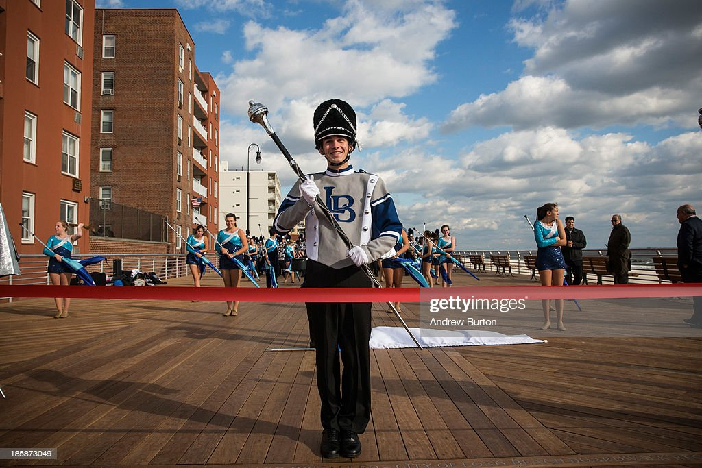 Alex Schneider, of the Long Beach High School marching band prepares to march down the Long Beach boardwalk during a ceremony to officially reopen the boardwalk on October 25, 2013 in Long Beach, New York. The boardwalk was severely damaged by Superstorm Sandy last year, which killed 285 people and caused billions of dollars in damage. Long Beach's new boardwalk is made of Brazilian hardwood and is estimated to have a lifespan of 30-40 year; the previous boardwalk was only scheduled to last three to seven years.