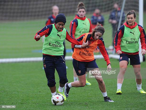 Alex Scott and Vicky Losada of Arsenal Ladies in action during their training session at London Colney on January 29 2016 in St Albans England