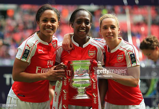 Alex Scott Danielle Carter and Jordan Nobbs of Arsenal celebrate victory with the trophy after the SSE Women's FA Cup Final between Arsenal Ladies...