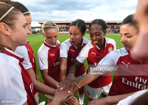 Alex Scott flanked by Jordan Nobbs and Danielle Carter of Arsenal gives some motivational words before the match between Arsenal Women and Everton...