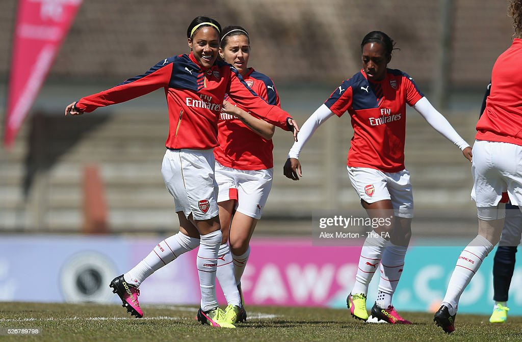 Alex Scott, Jemma Rose and Dan Carter of Arsenal warms up prior to the WSL match between Arsenal Ladies and Birmingham City Ladies at Meadow Park on May 1, 2016 in Borehamwood, England.