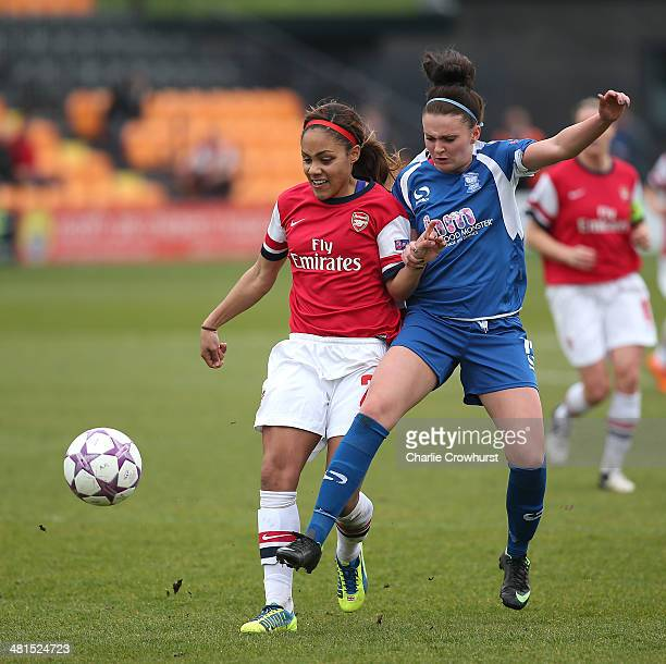 Alex Scott of Arsenal battles with Melissa Lawley of Birmingham for the ball during the Womens UEFA Champions League Quarter Final match between...