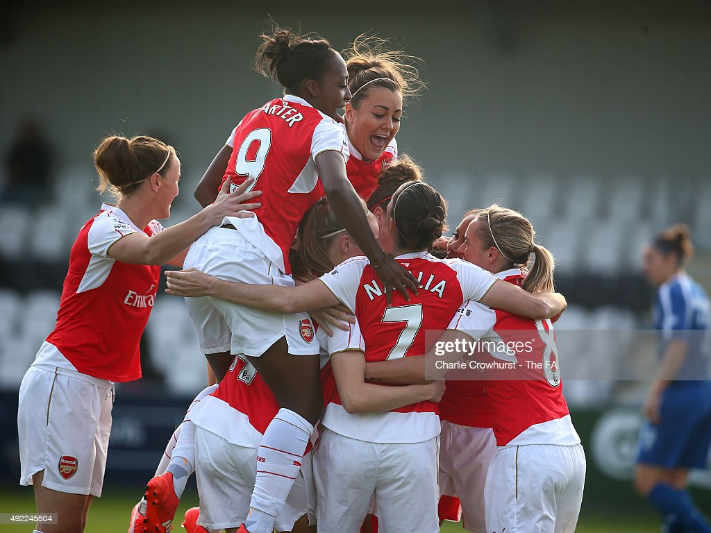 Alex Scott of Arsenal celebrates with team mates after scoring the teams third goal of the game during the Continental Cup SemiFinal match between...