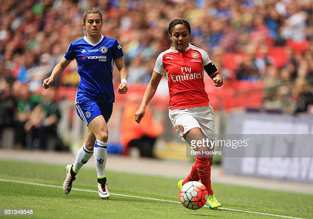 Alex Scott of Arsenal is chased by Karen Carney of Chelsea during the SSE Women's FA Cup Final between Arsenal Ladies and Chelsea Ladies at Wembley...