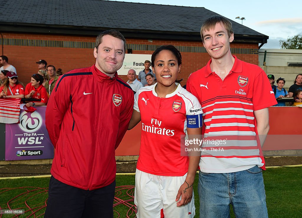 Alex Scott of Arsenal is congratulated on her Player of the Match performance by members of the Supporters Club during the FA WSL match between...