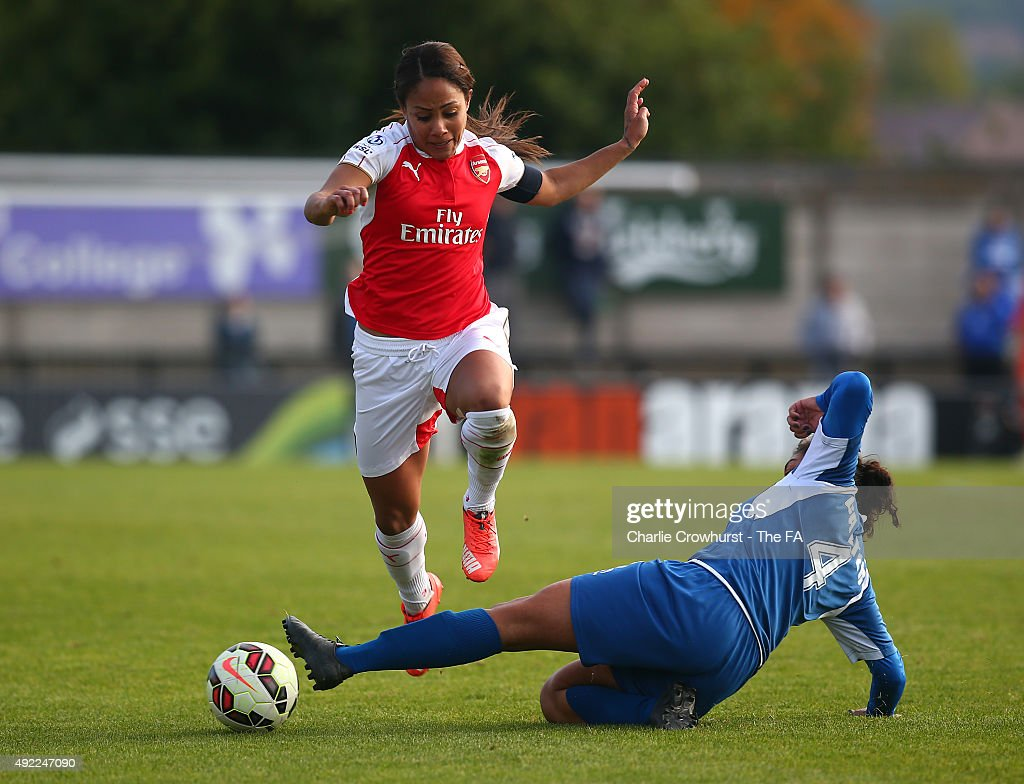 Alex Scott of Arsenal is tackled by Birmingham's Jessica Carter during the Continental Cup SemiFinal match between Arsenal Ladies and Birmingham City...