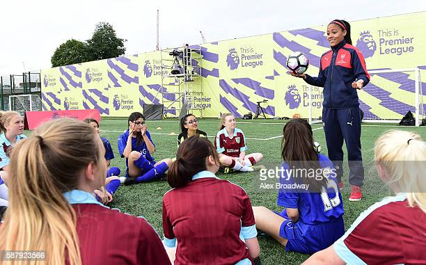Alex Scott of Arsenal Ladies chats with young players during the Official Premier League Season Launch Media Event held at Market Road pitches on...