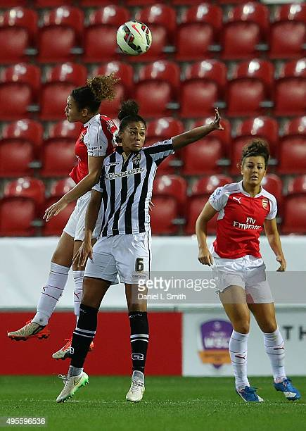 Alex Scott of Arsenal Ladies FC and Fern Whelan of Notts Ladies County FC head the ball during the WSL Continental Cup Final between Arsenal Ladies...