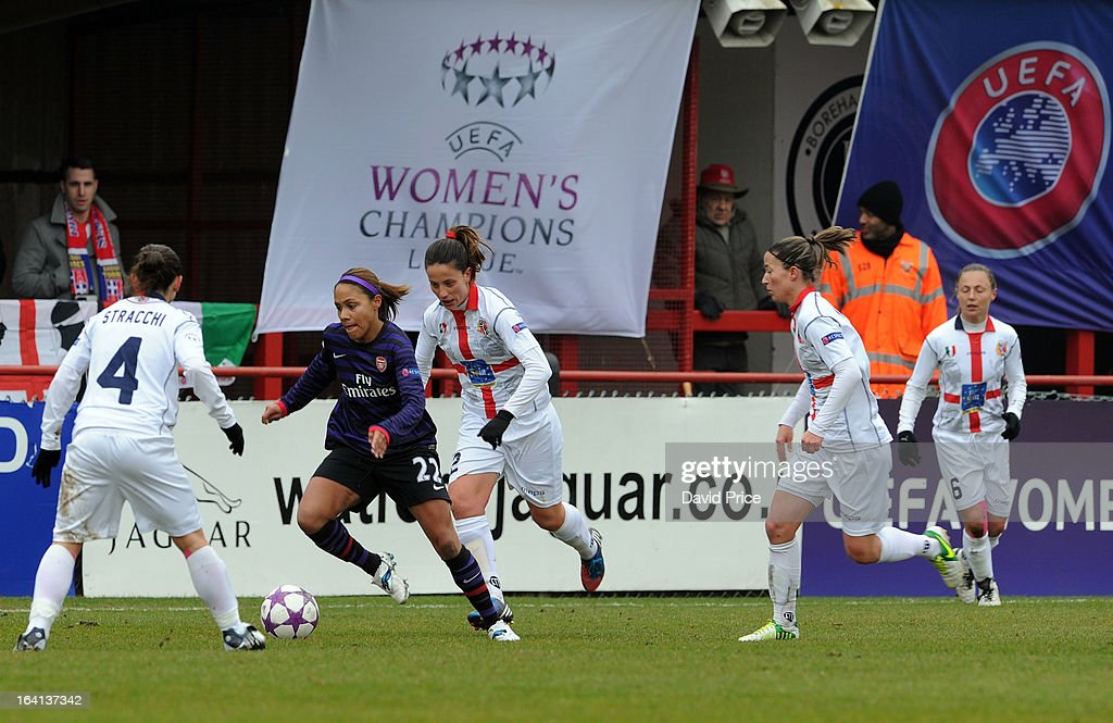 Alex Scott ('nd L) of Arsenal Ladies FC runs at Daniela Stracchi (L) of Torres during the Women's Champions League Quarter Final match between Arsenal Ladies FC and ASD Torres CF at Meadow Park on March 20, 2013 in Borehamwood, United Kingdom.
