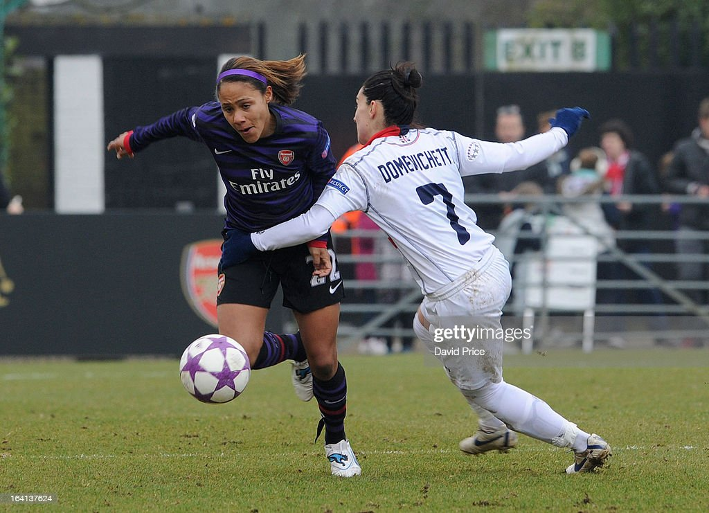 Alex Scott of Arsenal Ladies FC takes on Giulia Domenichetti of Torres during the Women's Champions League Quarter Final match between Arsenal Ladies FC and ASD Torres CF at Meadow Park on March 20, 2013 in Borehamwood, United Kingdom.