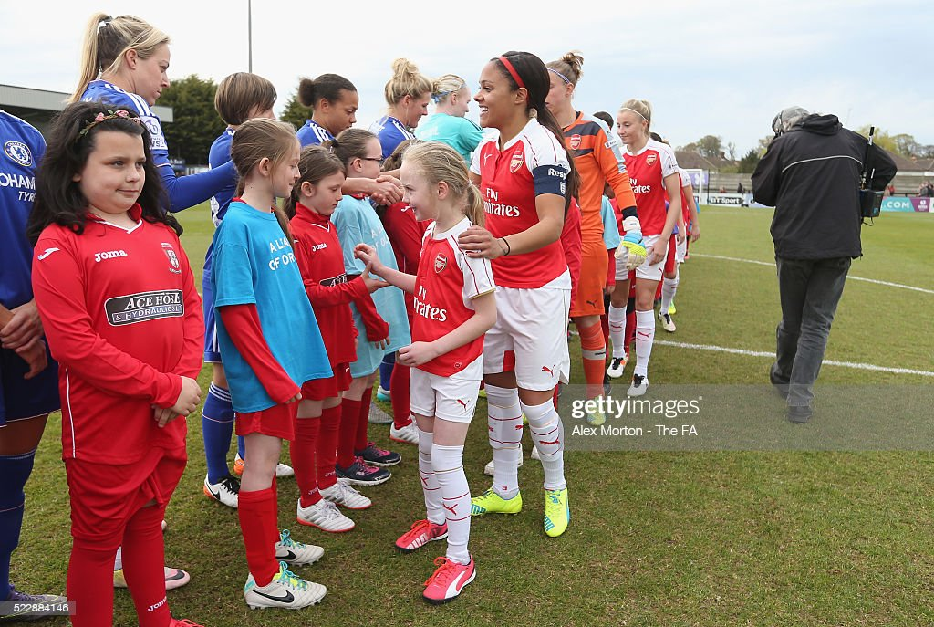 Alex Scott of Arsenal shakes hands with Chelsea players prior to the WSL match between Arsenal Ladies FC and Chelsea Ladies FC at Meadow Park on...