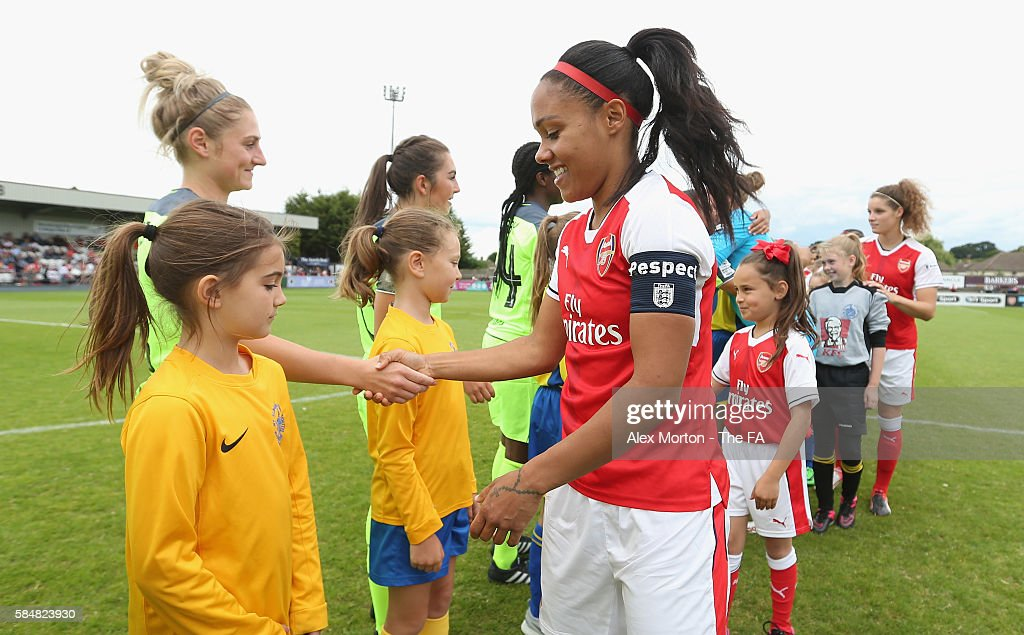 Alex Scott of Arsenal shakes hands with Liverpool players prior to the WSL match between Arsenal Ladies and Liverpool Ladies at Meadow Park on July...