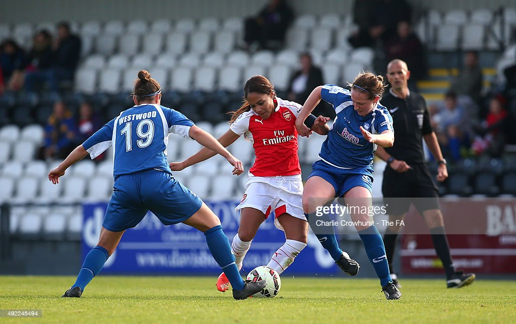 Alex Scott of Arsenal takes on the Birmingham defence during the Continental Cup SemiFinal match between Arsenal Ladies and Birmingham City Ladies at...