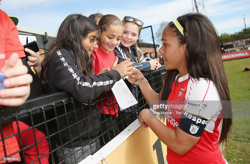 Alex Scott of Arsenal with fans after the WSL match between Arsenal Ladies and Birmingham City Ladies at Meadow Park on May 1, 2016 in Borehamwood, England.