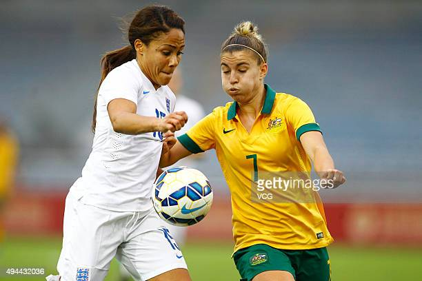 Alex Scott of England and Stephanie Catley of Australia compete for the ball in the match between England and Australia during the 2015 Yongchuan...