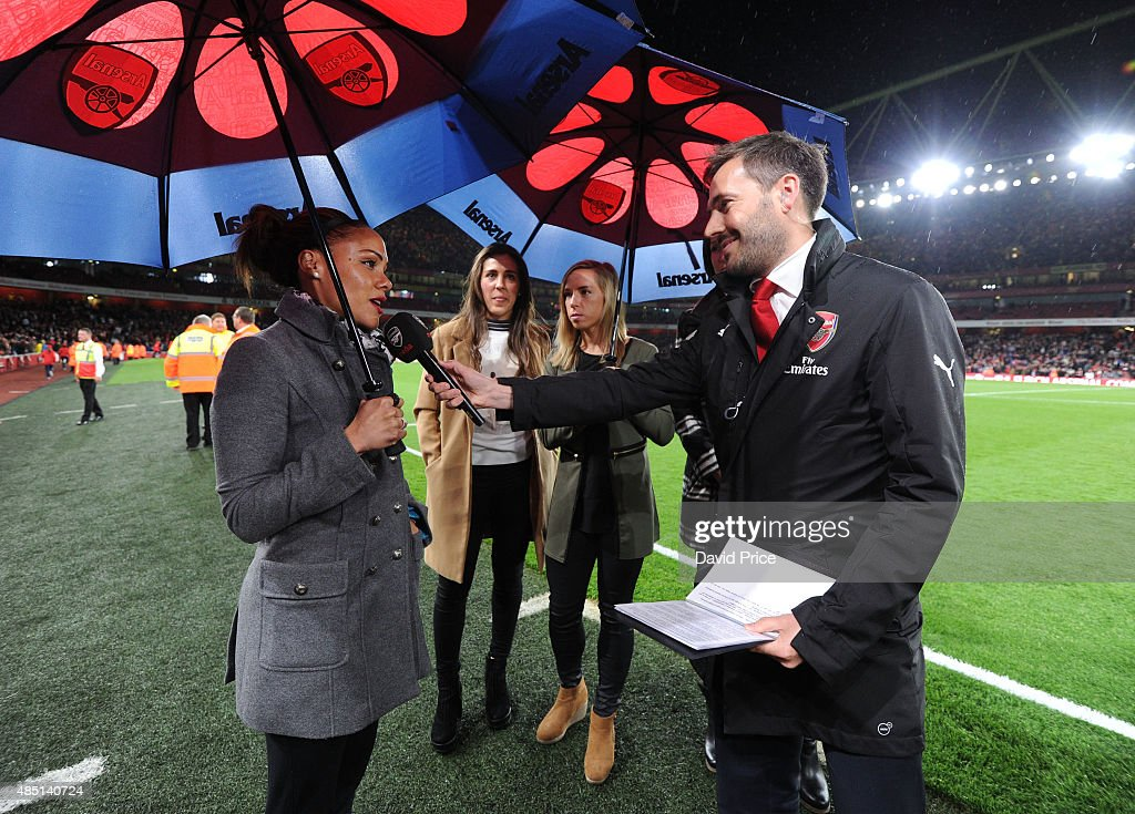 Alex Scott of the Arsenal Ladies is interviewed by Nigel Mitchell during half time of the Barclays Premier League match between Arsenal and Liverpool...