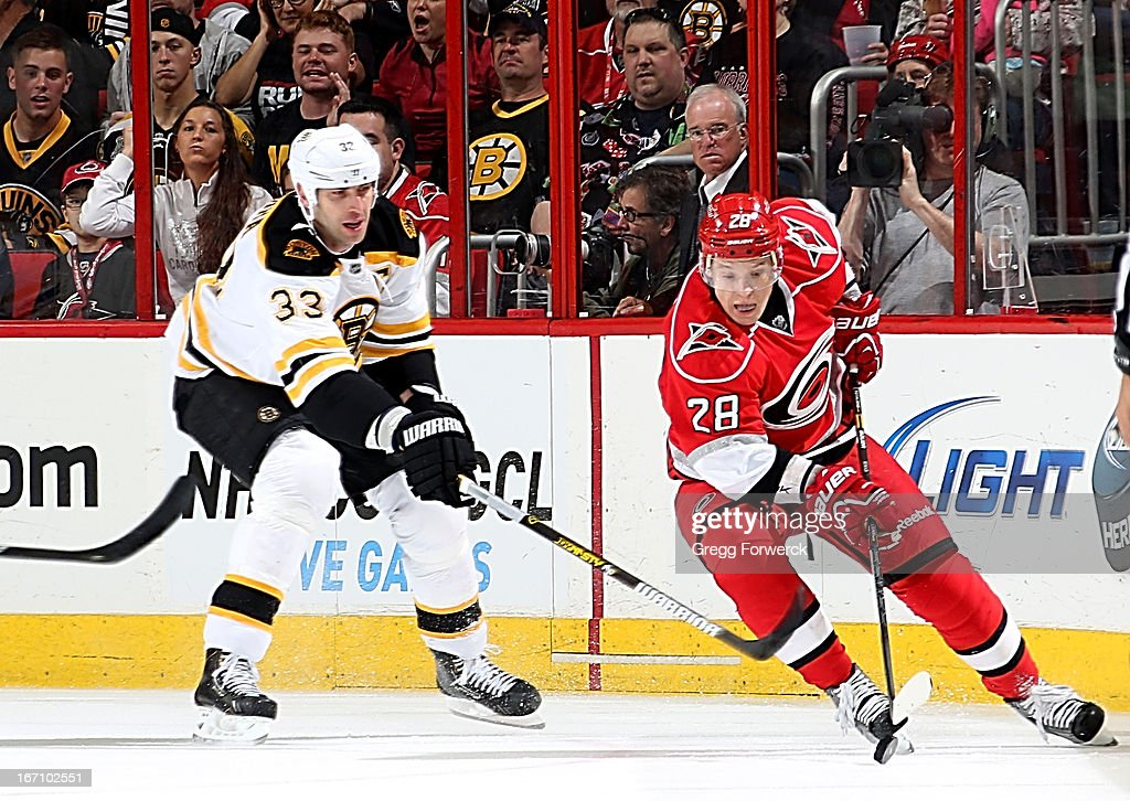Alex Semin #28 of the Carolina Hurricanes battles for a loose puck against <a gi-track='captionPersonalityLinkClicked' href=/galleries/search?phrase=Zdeno+Chara&family=editorial&specificpeople=203177 ng-click='$event.stopPropagation()'>Zdeno Chara</a> #33 of the Boston Bruins during an NHL game at PNC Arena on April 13, 2013 in Raleigh, North Carolina.